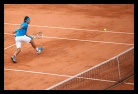 Rafael Nadal playing tennis on clay court