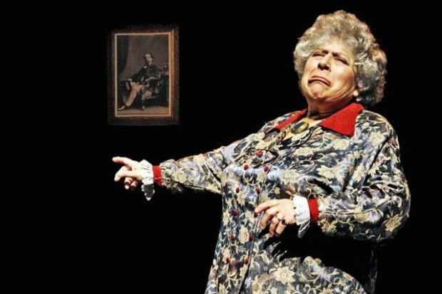 Myriam Margolyes acting in front of Dickens portrait