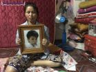 4_sok_noeun_36_holds_a_portrait_of_her_late_son_phal_narou_15_who_was_beaten_by_a_mob_after_he_was_caught_stealing_last_week_in_phnom_penh_erin_handley_2